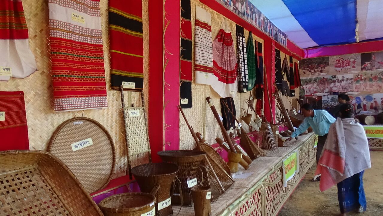 Exhibits dresses, household instruments of the tribes of tripura